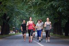 People group jogging stock image