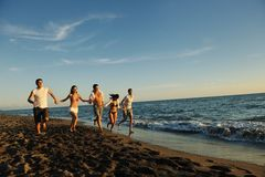 People group running on the beach Stock Photography