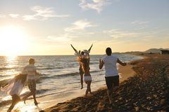People group running on the beach Stock Image