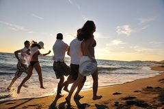 People group running on the beach Stock Images