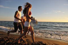 People group running on the beach Royalty Free Stock Images