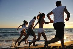 People Group Running On The Beach Royalty Free Stock Photography