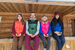 People Group Sitting On Terrace Wooden Country House Winter Snow Resort Cottage Stock Image