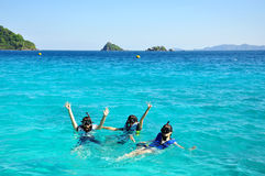 People group with snorkel on ocean Stock Photos