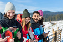 People Group With Snowboard Ski Resort Snow Winter Mountain Cheerful Friends Cahtting Online Smart Phone Stock Photography