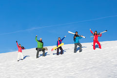 People Group With Snowboard And Ski Resort Snow Winter Mountain Cheerful Friends. Extreme Sport Vacation stock photography
