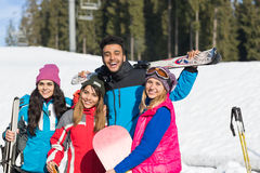 People Group With Snowboard And Ski Resort Snow Winter Mountain Friends Communication Stock Images
