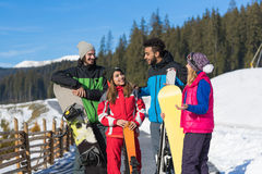 People Group With Snowboard And Ski Resort Snow Winter Mountain Friends Communication Stock Photo