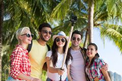 People Group Take Selfie With Action Camera On Stick While Walking In Palm Tree Park On Beach, Happy Smiling Mix Race Royalty Free Stock Photos