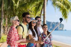 People Group Take Selfie With Action Camera On Stick While Walking In Palm Tree Park On Beach, Happy Smiling Mix Race Royalty Free Stock Photography