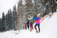 People Group Taking Photo On Smart Phone Winter Snow Mountain Forest, Young Friends Christmas Holiday Stock Photo