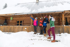 People Group Taking Selfie Photo On Smart Phone Near Wooden Country House Winter Snow Resort Cottage Royalty Free Stock Images