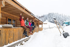 People Group Taking Selfie Photo On Smart Phone Terrace Wooden Country House Winter Snow Resort Cottage. Friends On Vacation Stock Photography