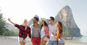 People Group Talking On Beach Taking Selfie Photo On cell Smart Phone Young Men And Women Tourists Communication stock footage