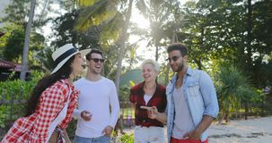 People Group Talking Over Tropical Palm Tree Park Happy Laughing Men And Women Communication stock footage