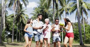 People Group Talking Use Cell Smart Phones Walking Outdoors Under Palm Trees, Happy Smiling Mix Race Man And Woman. Communication Slow Motion 60 stock video footage