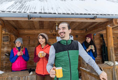 People Group On Terrace Holding Cup Hot Coffee Tea Wooden Country House Winter Resort Royalty Free Stock Photography