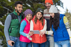 People Group Using Smart Phone Snow Forest Happy Smiling Young Friends Walking Outdoor Winter Royalty Free Stock Photo