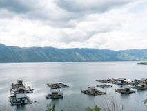 Floating Fish Cages Farming in the Lut Tawar Lake, Takengon, Ace. People grow fish in their local ponds using a simple fish cage in Lut Tawar Lake, Takengon royalty free stock photo