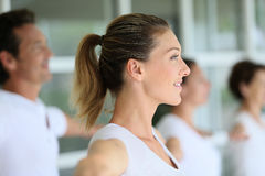 People guided by a woman during the yoga class Royalty Free Stock Photo