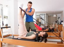 People in the gym with modern fitness equipment royalty free stock images