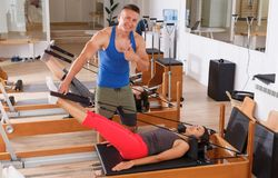 People in the gym with modern fitness equipment stock image