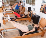 People in the gym with modern fitness equipment royalty free stock photos