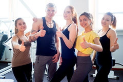 People at gym thumbs up Stock Photos
