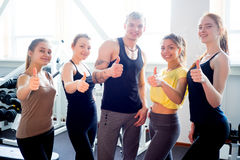 People at gym thumbs up Royalty Free Stock Photos