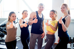 People at gym thumbs up Royalty Free Stock Photo