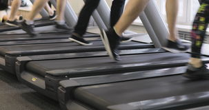 People in the gym treadmill cardio workout. Legs on a treadmill, People in the gym treadmill cardio workout stock video footage