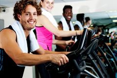 People at gym working out happily Stock Photos