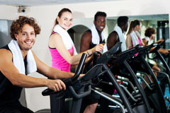 People at gym working out happily Royalty Free Stock Photos