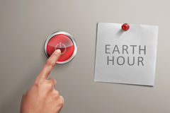 People hand with Earth hour note turning off electrical equipmen Royalty Free Stock Photos