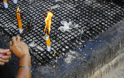 People hand fire the joss stick Stock Images