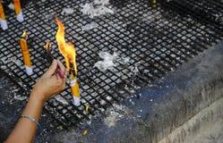People hand fire the joss stick Stock Photo