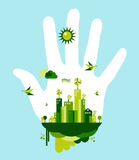 Go green city hand concept. People hand and green city town on blue sky background. Environmental conservation concept illustration. Vector file layered for easy Royalty Free Stock Image