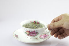 People hand holding the cup of tea Stock Photography
