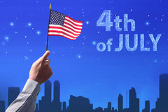 People hand holding the flag of USA celebrating 4th of July Royalty Free Stock Photos