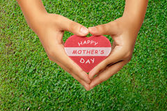 People hand holding heart with Happy Mothers day greeting Stock Image