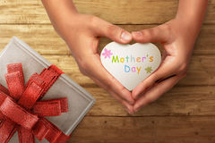 People hand holding heart with Happy Mothers day greeting Royalty Free Stock Photo