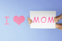People hand holding paper to make Mothers day message Stock Image