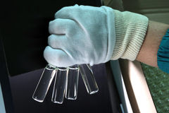 People hand holding a test tube vial sets for analysis in the gas liquid chromatograph. Laboratory assistant inserting laboratory. Scientist holds a chemical stock photos