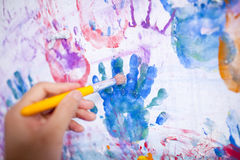 People hand painting the wall Royalty Free Stock Images