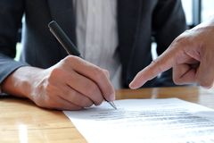 People hand pointing to sign documents. Business concepts stock image