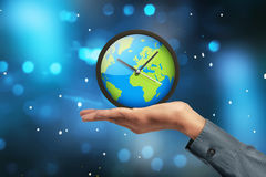 People hand showing earth globe clock Royalty Free Stock Photography