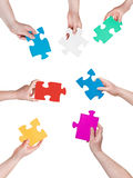 People hands circle with different puzzle pieces Royalty Free Stock Photo