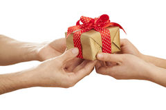People hands give gift in box Royalty Free Stock Images
