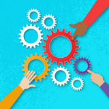 People hands hold colorful gears - mechanism system.Cogwheels. Stock Image