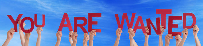People Hands Hold Red Word You Are Wanted Blue Sky Stock Photos